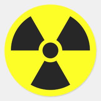 Símbolo amonestador de la radiación pegatina redonda