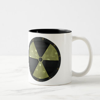 Símbolo amonestador radiactivo tazas de café