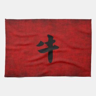 Símbolo chino de la caligrafía para el buey en toalla de cocina