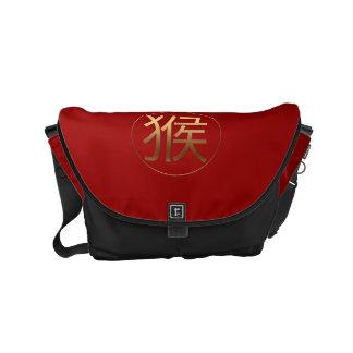 Símbolo chino de oro del Año Nuevo del mono Bolsa De Mensajería