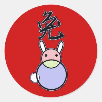 Símbolo chino del conejo con arte del círculo pegatinas redondas