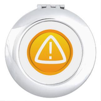 Símbolo de la precaución de la atención espejos compactos