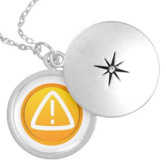 Símbolo de la precaución de la atención medallones