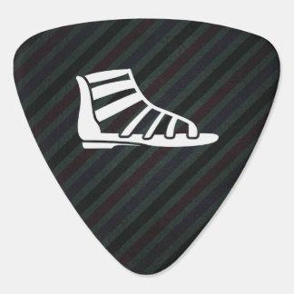 Símbolo de las sandalias del gladiador plumilla de guitarra