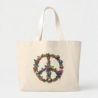 Símbolo de paz de la mariposa bolsas lienzo