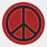Símbolo de paz rojo y negro pegatina redonda