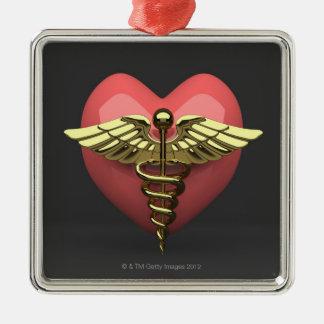 Símbolo del corazón con el símbolo médico adorno cuadrado plateado