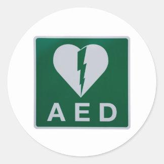 Símbolo del Defibrillator del AED Pegatina Redonda