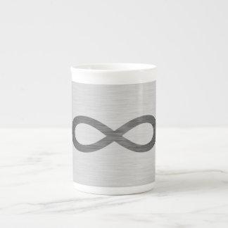 Símbolo del infinito en falsa textura del metal taza de té