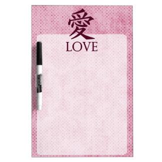 Símbolo del kanji del amor en fondo texturizado ro pizarras