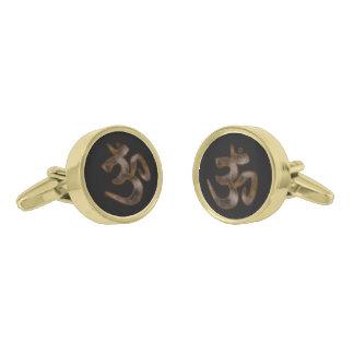 Símbolo del ohmio gemelos dorados