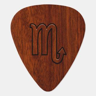 Símbolo del zodiaco del escorpión en el estilo de púa de guitarra