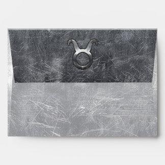 Símbolo del zodiaco del tauro en estilo apenado sobres