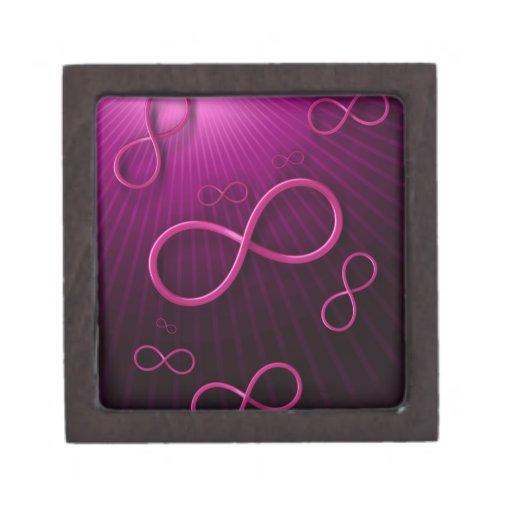 Símbolo femenino del infinito en fondo magenta caja de regalo de calidad