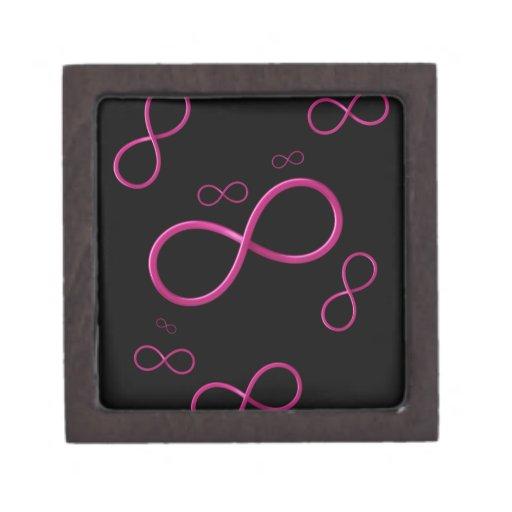 Símbolo femenino del infinito en fondo negro caja de recuerdo de calidad