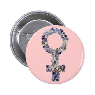 Símbolo femenino hecho con los pedazos del rompeca pin