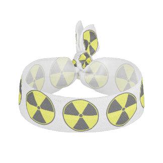 Símbolo ionizante radiactivo banda para el cabello