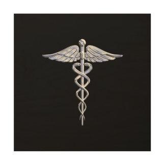 Símbolo médico del caduceo en negro cuadros de madera