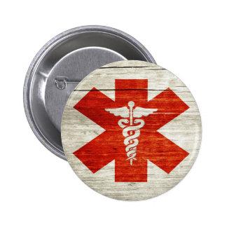 Símbolo médico del caduceo rojo pin redondo 5 cm