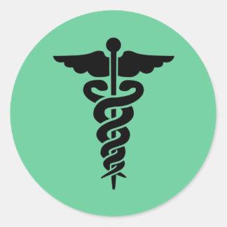 Símbolo médico pegatina redonda