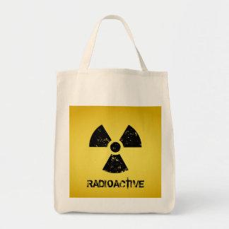 Símbolo radiactivo amarillo bolsa tela para la compra