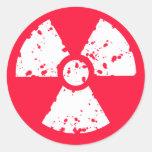 Símbolo radiactivo tóxico rojo del escarlata etiqueta redonda