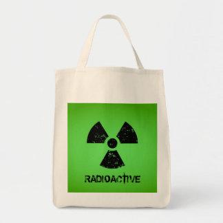 Símbolo radiactivo verde bolsa tela para la compra