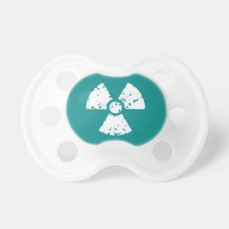 Símbolo radiactivo verde del trullo chupetes de bebe