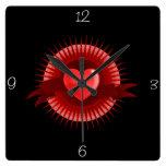 Símbolo rojo del corazón reloj