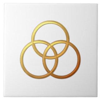 """Símbolo """"tridimensional"""" de oro de la trinidad azulejos cerámicos"""