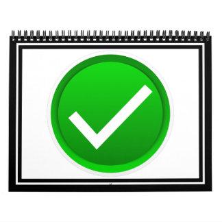 Símbolo verde de la marca de verificación calendario de pared