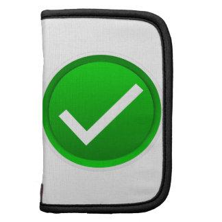 Símbolo verde de la marca de verificación planificador