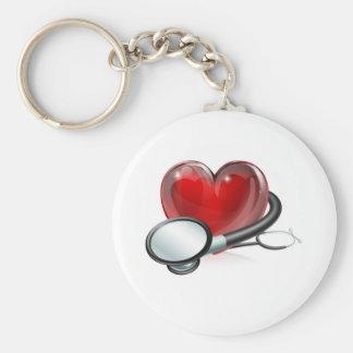 Símbolo y estetoscopio del corazón llavero redondo tipo pin