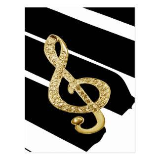 Símbolos del gclef del piano del oro tarjeta postal