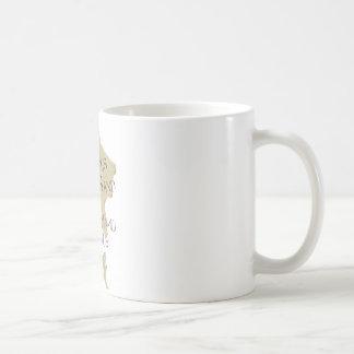 Símbolos en la arena tazas de café