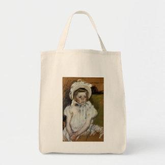 Simone en un capo blanco bolsa tela para la compra