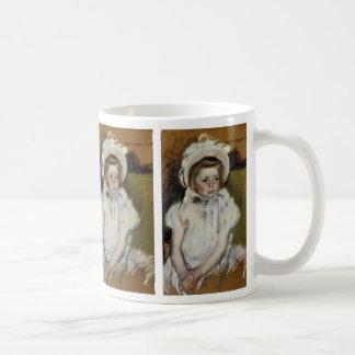 Simone en un capo blanco tazas de café