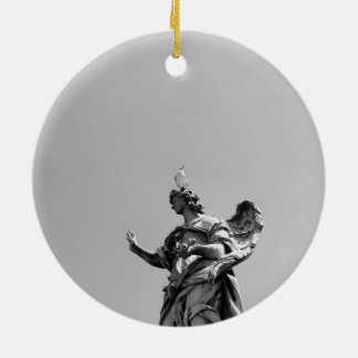 Simple, modern photo of seagull on top of statue ceramic ornament
