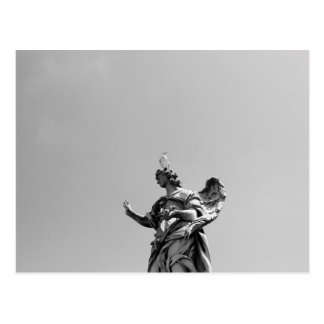 Simple, modern photo of seagull on top of statue postcard
