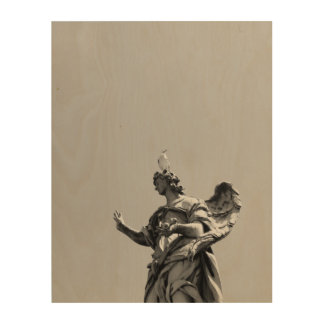 Simple, modern photo of seagull on top of statue wood wall art