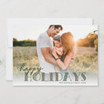 """Simple Modern Typography Olive Happy Photo Holiday Card<br><div class=""""desc"""">This simple, modern Holiday photo card features your full-bleed photo on the front, along with stylish typography in dark olive green, reading """"Happy Holidays"""" over a white gradient overlay. The back of the card contains a pine bough and berries pattern in white over a custom color background (shown in olive...</div>"""