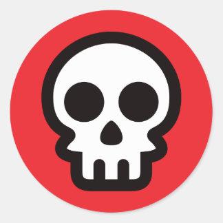 Simple skull logo on red background, round sticker