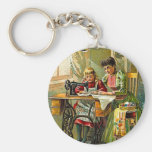 """Singer Sewing Machine """"The First Lesson"""" Vintage Key Chain"""
