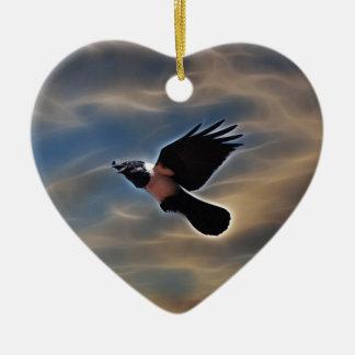 Singing raven in flight ceramic ornament