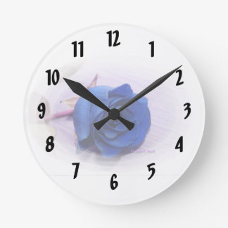 Single blue rose within an oval Frame Round Clock