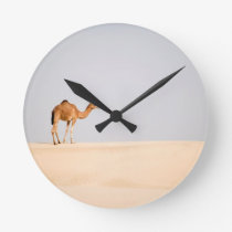 Single camel on Arabian sand dunes Round Clock