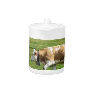 Single cow in an alpine pasture teapot