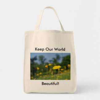 Single dandelion against the field tote bag
