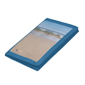 Single footprint on the beach. trifold wallet