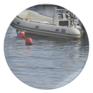 Single inflatable dinghy with outboard motor dinner plate